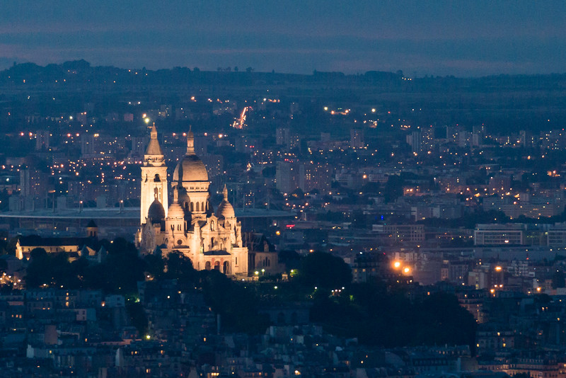 Sacré-Cœur lit up in the evening.