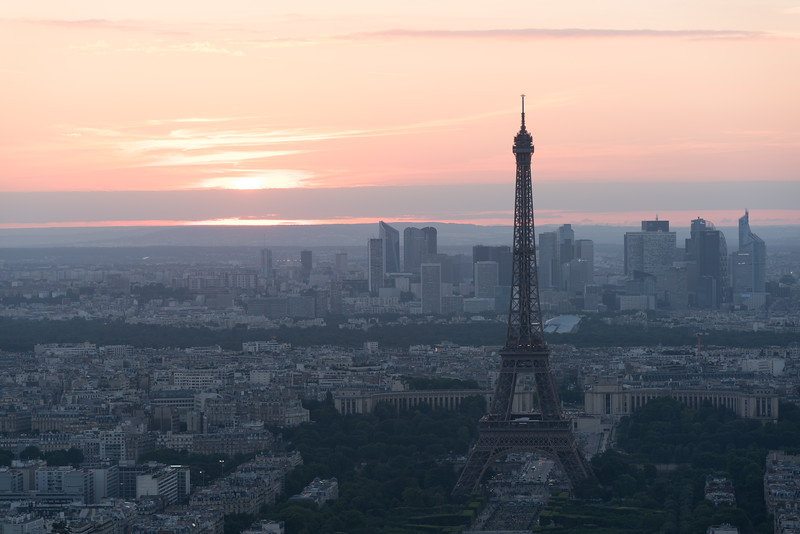 Sunset against newer Paris (high rises in background) and La Tour Eiffel.