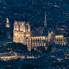 Notre-Dame de Paris lit up in the evening.