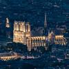 Notre-Dame de Paris lit up in the evening.