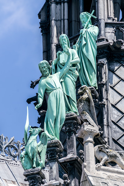 3 of the 12 disciples/apostles on the southwest side of the spire.