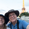 Tourists on la Seine with La Tour Eiffel in the background.