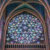 Rose window closeup with depictions of the Apocalypse of John.