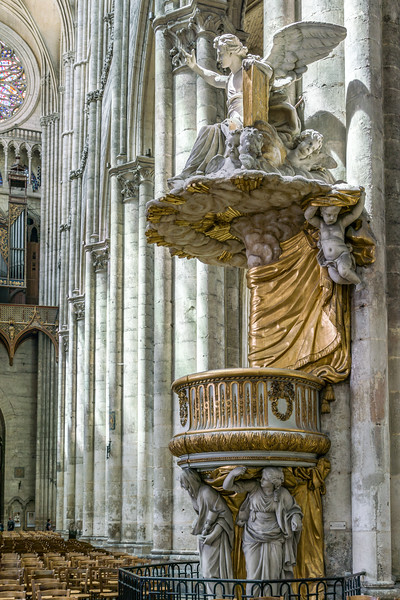 The pulpit with Faith, Hope and Love supporting it on the bottom.
