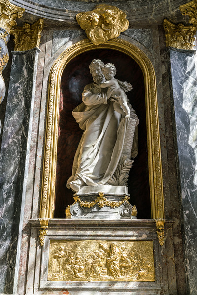Statue of St. Joseph with a bas-relief of the Israelites collecting manna in the wilderness.