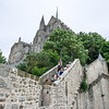 Climbing the ramparts up to the abbey.