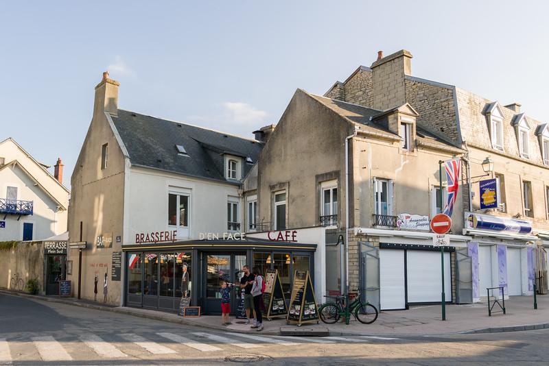 The restaurant - Brasserie d'en Face. Name could mean Restaurant on the Opposite (side?).
