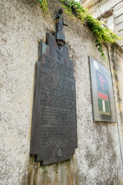 Plaque and insignia remembering the 50th Northumbrian infantry division of the British Army.