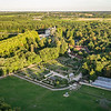 View of Château Chenonceau in the background with its farm buildings, herb and vegetable gardens in the foreground.