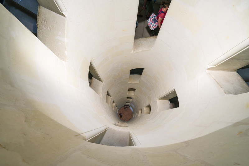 View from the top of the double helix staircase, showing how light from the top can illuminate multiple floors of the staircase.