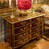 A Boulle style Louis 14th chest of drawers, inlaid with red tortoise shell, brass and wood. (The creation of the chest of drawers - which replaced the trunk as the preferred way of storing things - is attributed to André-Charles Boulle.)