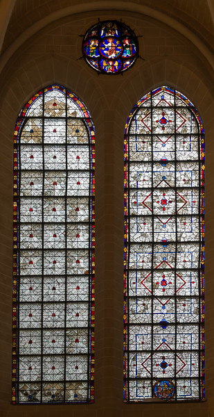 Two Grisaille windows with a Christ window on top