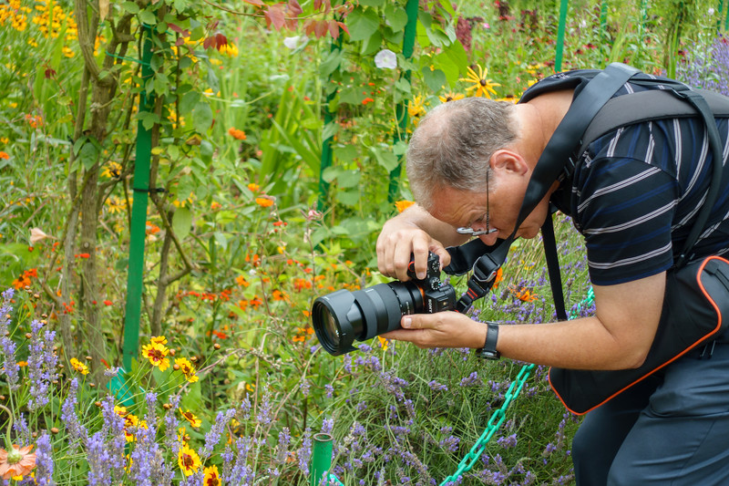 The photographer and the flowers.
