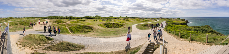 Pointe du Hoc and its craters. Can you spot any of the goats in the background?