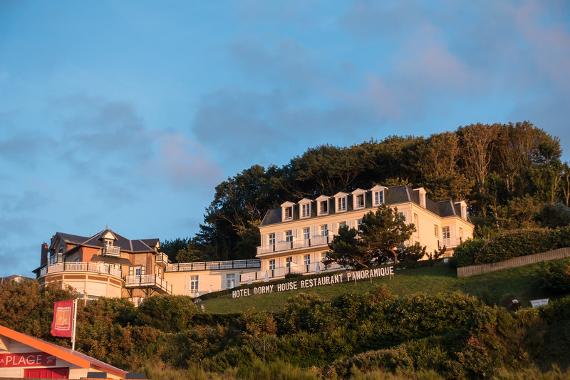 Dormy House, reflecting light from the evening sunset.