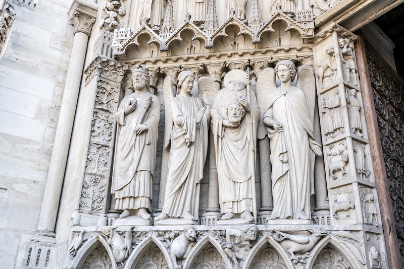 Constantine, and angel, Saint Denis (holding his head) and another angel.