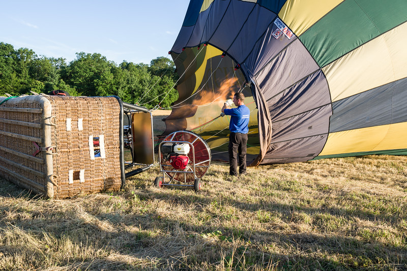 Now, start heating up the air inside the balloon while still putting more air in.