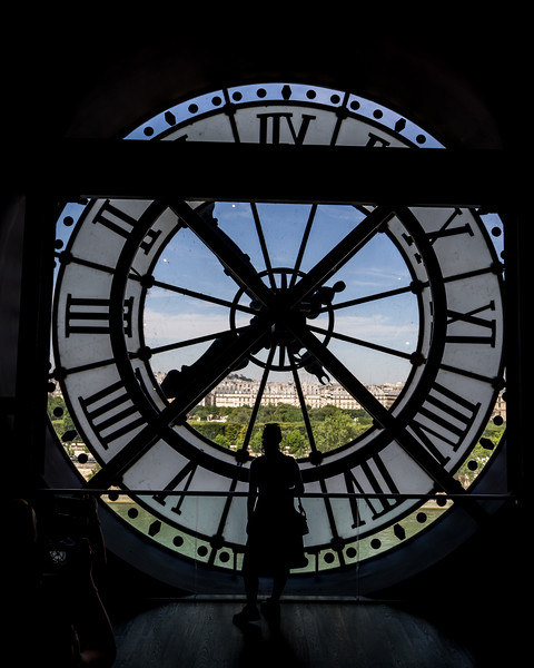 Silhouette behind the clock.