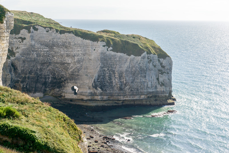 What causes holes like that in the cliffs?