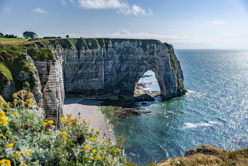 Can you find the people on the beach and under the arch? (These cliffs are big!) This arch is called Manneport.