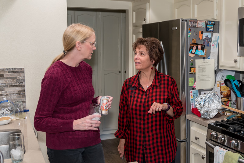 Nancy and Naomi conferring in the kitchen regarding setting up the meal.