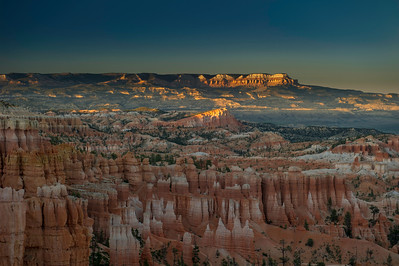 Sinking Ship and Powell Point are splashed with the last sun of the day, from the Rim Trail near the lodge