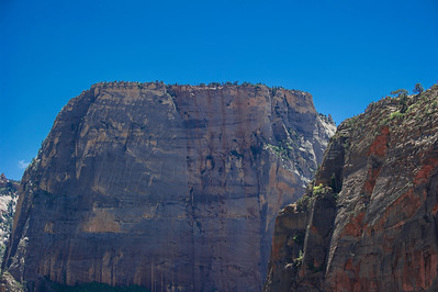 To the right, people on the top of Angels Landing