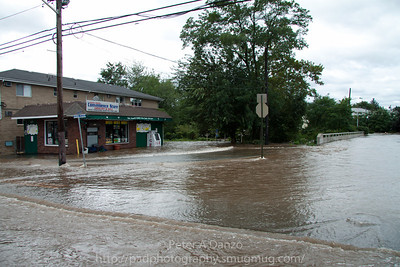 Lodi NJ, Main St & Borig Pl. the Saddle River rapidly rising and washing over the Borig Pl bridge.