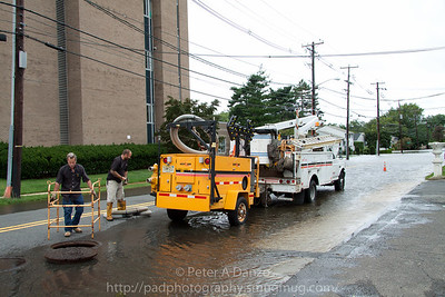 Rochelle Pk NJ, Passaic St in front of the Verizon Bldg, Verizon crew just arrived with large pump to try and alleviate flooding of switching equipment.