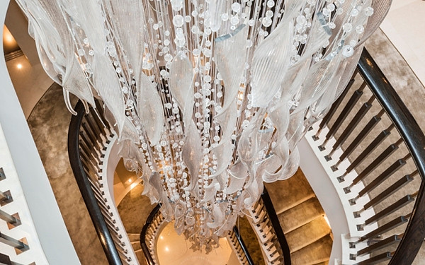 """7. Having a luxurious long chandelier hanging down the stairs is very """"in"""" at the moment! Would make a nice foreground piece of dressing for the shot of Mother going down the stairs, met by Son half way down?"""