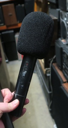 News interviewer microphone. Includes box with grey logo.