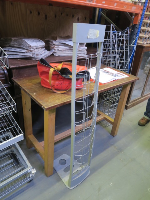 Magazine rack by door for Robber to kick over sending contents flying.