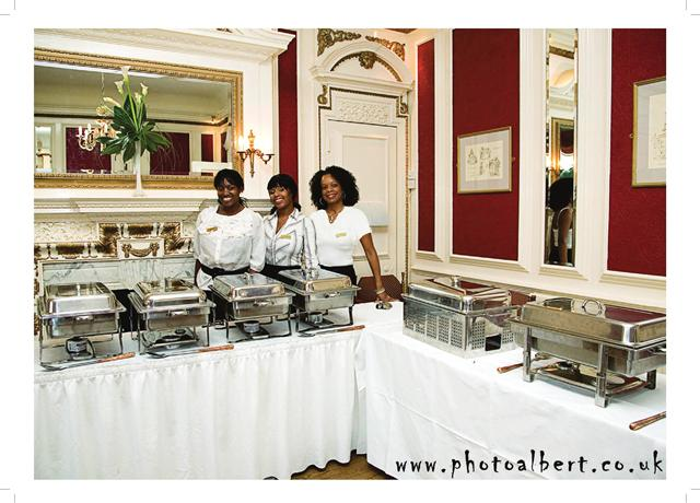 14. We could have a long row of catering buffet containers like this on one side, gusts standing in front.