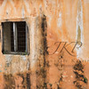 Terra Cotta colored wall with a screened window