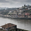 Portugal's Porto's skyline beside the river at dusk in the clouds