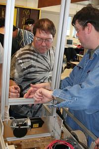 Mr. Haun and Dr. Skloss looking at the manipulator.