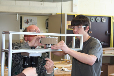 Mr. Taylor and Dylan building the drive train.
