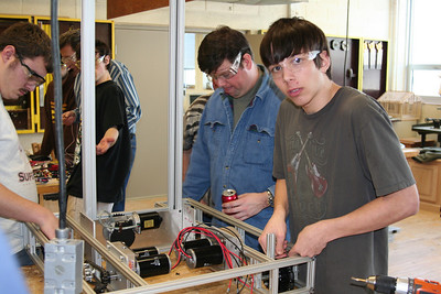 Dylan and Dr. Skloss working on the drive train. Is that a beverage in the work area? :O