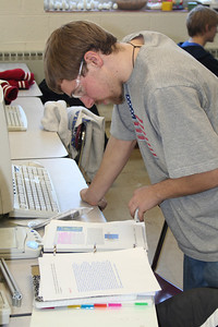 Chris working on the safety binder like a good safety captain. Thanks to this guy, we won the Championship award and raised the bar for all of FIRST!