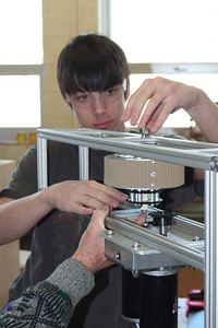 Dylan works with Mr. Taylor on the drive train.