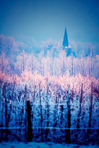 Winterlandschap, zicht op kerk vanaf Asse-ter-Heide