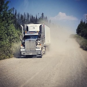 Trans-Labrador Trucking...high speed, rocks and dust. Have a few chips in my windshield and paint due to these guys. Lol