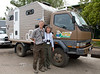Robert and Martine with Kookynet net in front of their custom Four Wheel Camper Shell - EXPO 2010