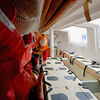 Lifeboat drill - each black spot is a seat. Food and water are under the seats. It will become obvious to us later that the seats a designed for penguin sized passengers.