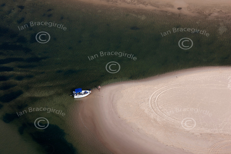 aerial photo of a boat on a sand bank in Australia.