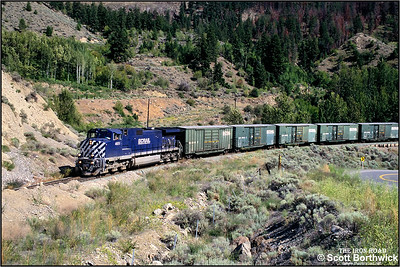 4651 passes through Fountain Indian Reserve, to the north of Lillooet, on 01/07/2001 with a Vancouver North-Prince George freight.