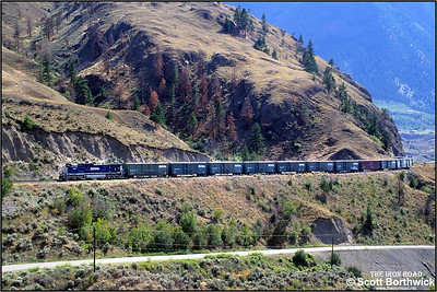 4651 slogs through Fountain Indian Reserve, to the north of Lillooet, on 01/07/2001 with a Vancouver North-Prince George freight.