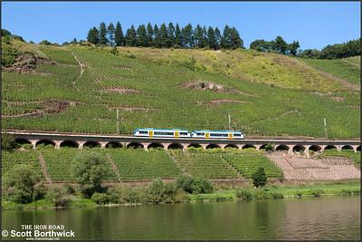 Stadler Regio-Shuttle RS1 diesel motor cars, 650132 'Frida'+650131 'Lilly' form RE87966 1422 Bullay (DB)-Traben Trarbach running along the 786m long Hangviadukt (slope viaduct) at Pünderich on 27/08/2016.
