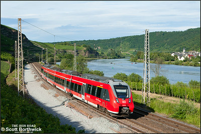 442 704 forms RB12240 1840 Koblenz Hbf-Trier Hbf passing Winningen on 07/07/2014.