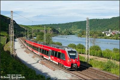 442 704 forms RB12240 1840 Koblenz Hbf-Trier Hbf passing Winningen on 07/07/2014.